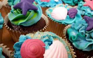 seashells gluten free cupcakes plus cutting cake aqua blue purple crimson party food melbourne image